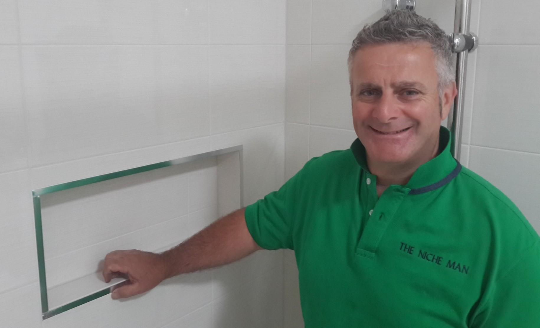 david-the-niche-man-standing-next-to-a-shower-niche